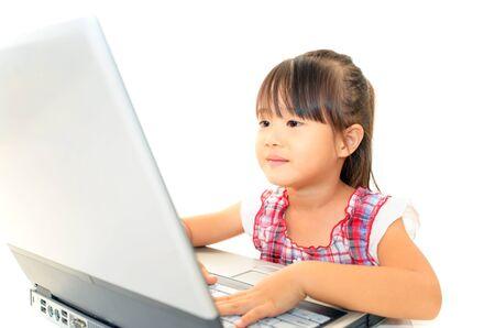 beautiful little girl using a laptop photo