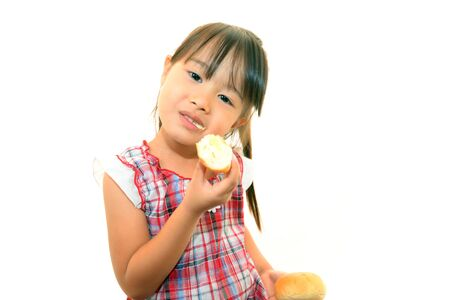 Little girl eating bread photo