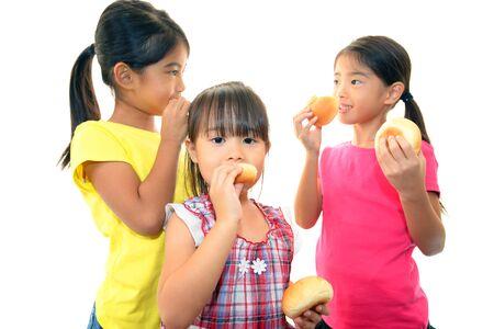 Little girls eating bread photo