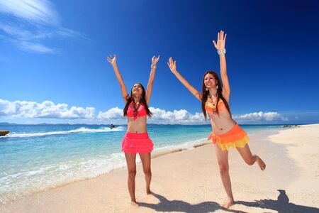 Women have a stretch on the beach Stock Photo - 15719798