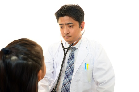 Doctor examining a patient photo