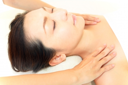 Smiling woman at massage spa photo
