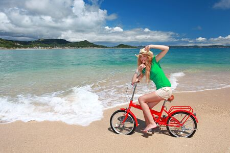Girl Riding a Bicycle on the Beach photo