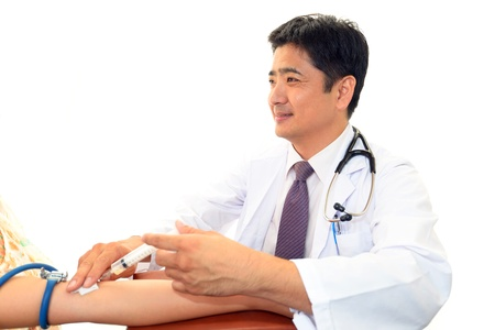 diphtheria: Smiling Asian medical doctor Stock Photo