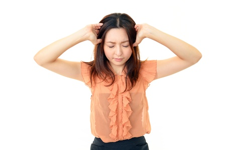 Woman holding her head, suffering from a headache  photo