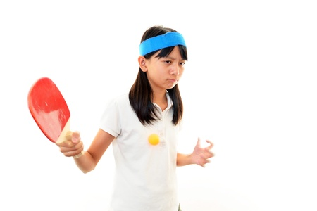 Girl playing table tennis photo