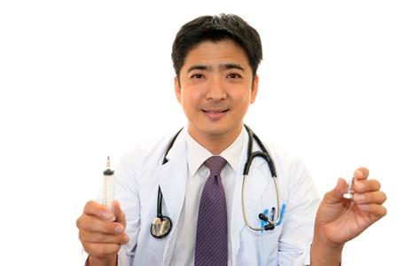 meningococcal: Smiling Asian medical doctor Stock Photo