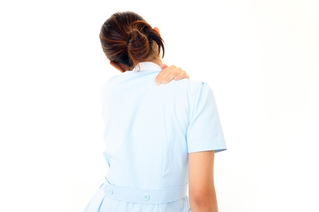 The nurse who is troubled with stiff shoulder photo
