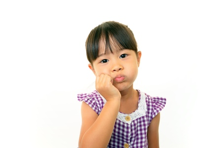 lugubrious: Little Asian girl uneasy look