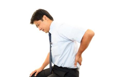 emotional pain: El hombre de negocios que est� preocupado por el dolor de espalda baja