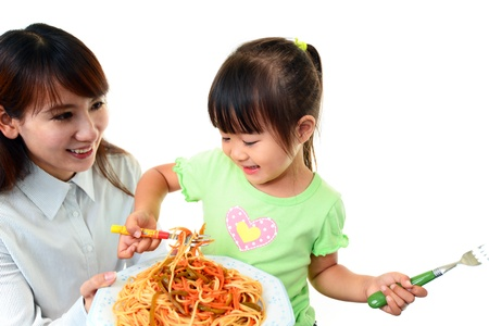 eating noodles: Child eating spaghetti Stock Photo