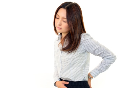 upset stomach: Stressed Business Woman Stock Photo