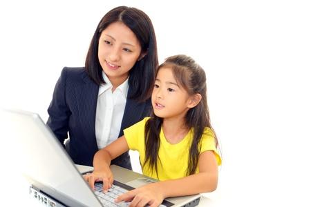 Smiling teenage girl using a laptop