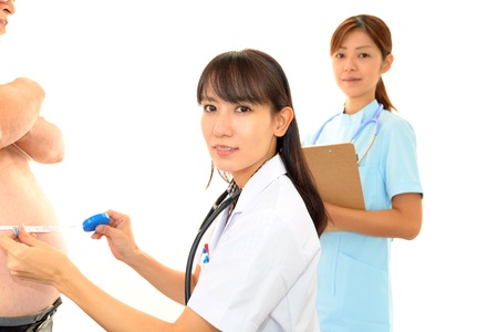 Physician with an examination of obese patients Stock Photo - 16029024