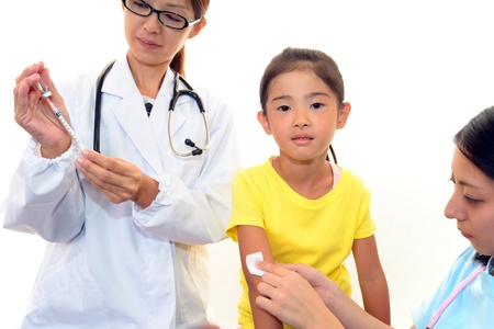 Doctor injecting child vaccine Stock Photo - 16051897