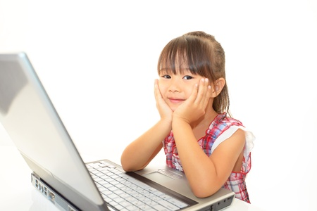 beautiful little girl using a laptop photo
