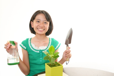 The girl who takes care of the plant
