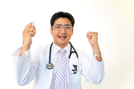 Smiling Asian medical doctor Stock Photo - 16169020