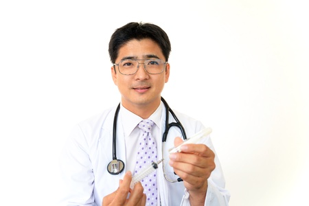 meningococcal: Smiling asian medical doctor