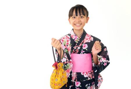 Smiling girl wearing a kimono photo