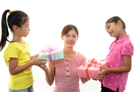 The girls who hand a present to mother Stock Photo