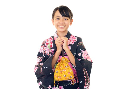 Smiling girl wearing a kimono photo