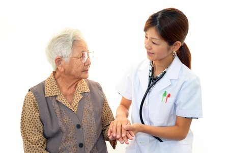 Old wonan and the medical staff of smile Stock Photo - 16497629