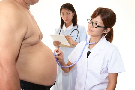 Physician with an examination of obese patients photo