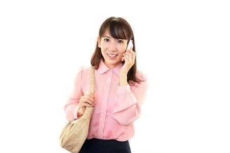 バッグで素敵な若い女性 写真素材