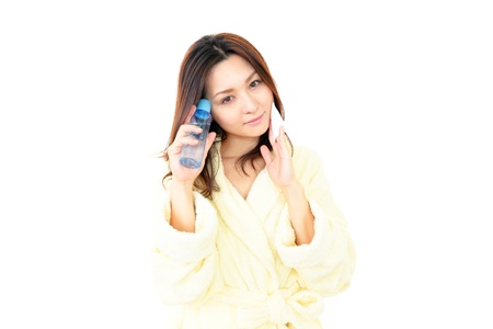 The woman who is doing skin care Stock Photo - 16484027