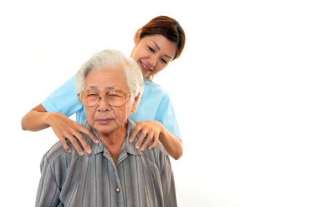 women s health: Friendly nurse cares for an elderly woman