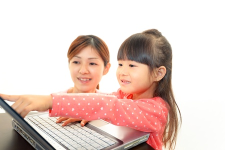 self exam: beautiful little girl using a laptop