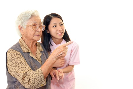 Senior woman with her home caregiver 免版税图像