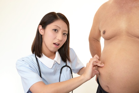 asian nurse: Nurse with an examination of obese patients