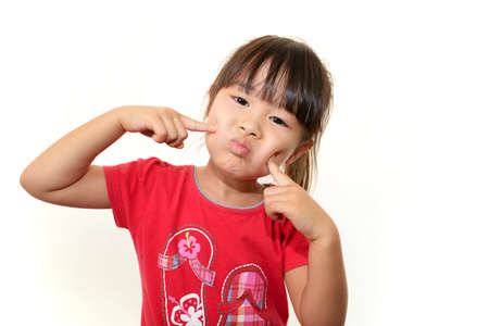 Happy little Asian girl smile Stock Photo - 16497680