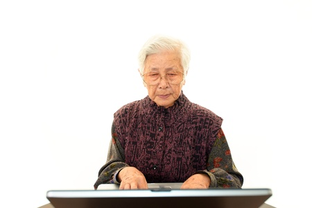 Senior Lady Enjoys Computer photo