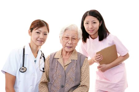 Old wonan and the medical staff of smile Stock Photo - 16687322