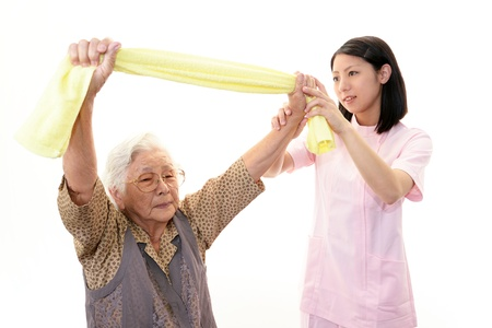 frailty: Senior woman with her home caregiver Stock Photo