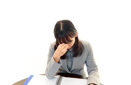 Tired and stressed young Asian woman Stock Photo - 16682094