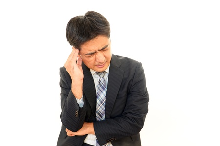 pay cuts: Expression of melancholy businessman Stock Photo