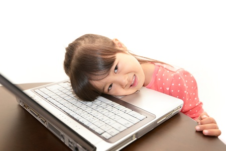 beautiful little girl using a laptop Stock Photo - 16715579