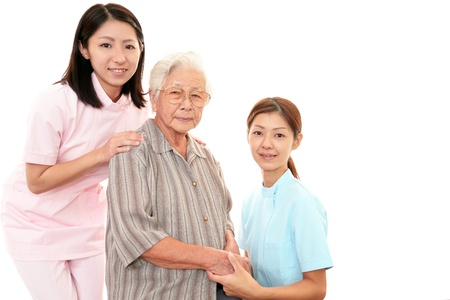 Senior woman with her home caregiver Stock Photo - 16847999