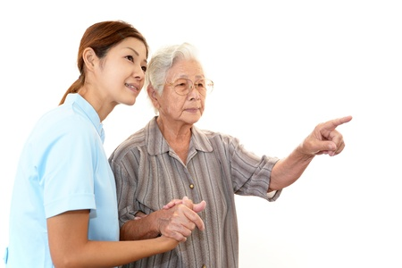 Old wonan and the medical staff of smile Stock Photo - 16931744