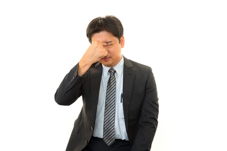 Tired and stressed Asian businessman Stock Photo - 16842594
