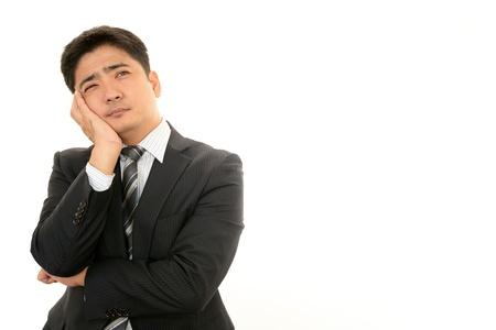 salaried: Expression of melancholy businessman