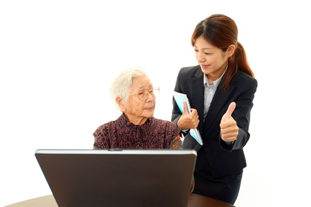 nursing class: Young woman helping an elderly lady use a computer