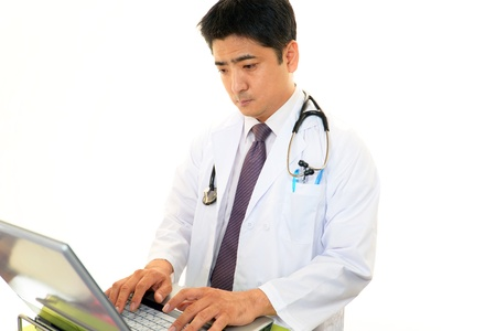 Doctor thinking Stock Photo - 16955595