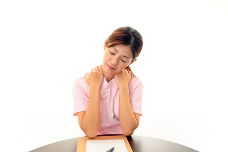 Nurse with shoulder neck pain photo