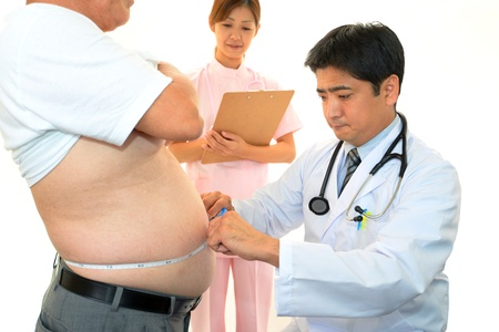 Physician with an examination of obese patients Stock Photo - 16964454