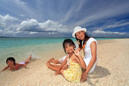 Family playing on the beach in Okinawa